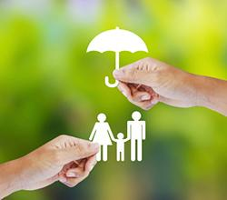 Asset Protection concept: paper cut out of family with paper umbrella covering them