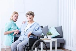 Elderly woman and caregiver