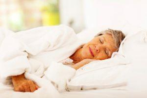senior woman sleeping thinking about retirement distribution planning