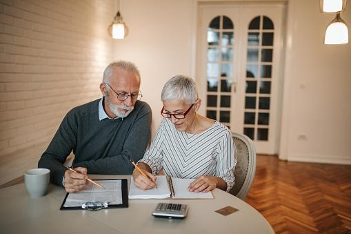 Senior couple looking over estate planning documents