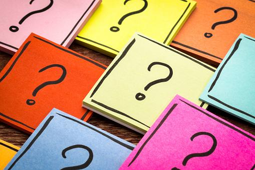 Notepads with question marks