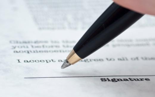 Someone signing paperwork to become an executor in California